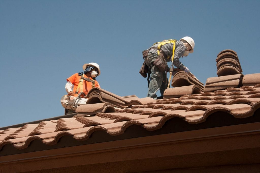 Roofers on top of a home replacing a roof in Calgary