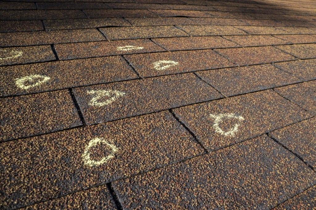 hail damage repair calgary,  what size hail will damage a roof, how does hail damage asphalt shingle,what size hail will damage a roof